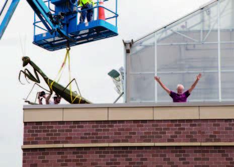 "Bruce celebrating installation of ""Lucille"""